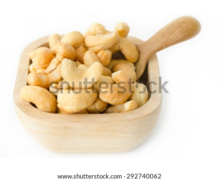 Cashew nuts in wooden bowl on white background. - stock photo