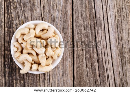 Cashew nuts on a white plate  - stock photo