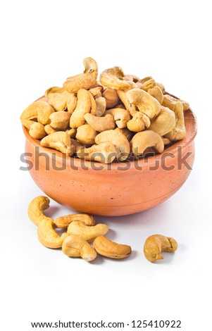cashews nut in bowl on white background - stock photo