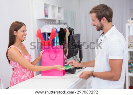 Cashier interacting with customer at a boutique - stock photo