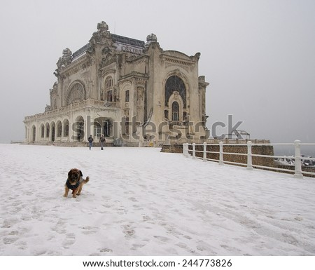 Casino building in Constanta, Romania,on the promenade waterfront at the Black Sea, in the middle of a big snowfall . - stock photo