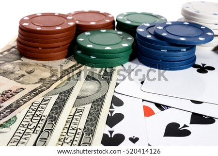 Casino chips and American money on a green table