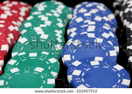 Casino chips close-up isolated on black