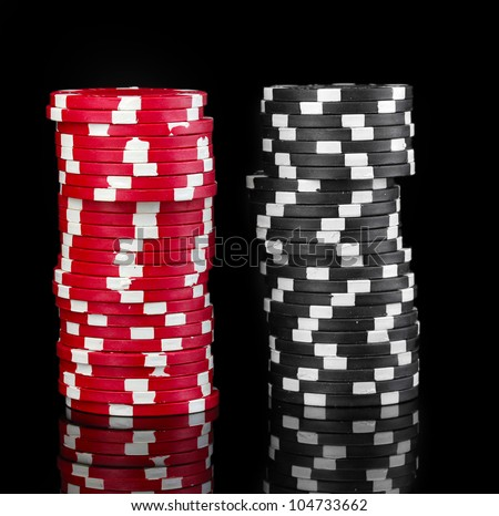 Casino chips isolated on black - stock photo