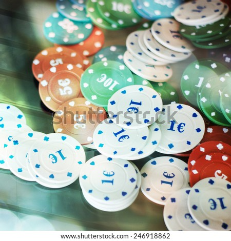Casino chips on a building background - stock photo