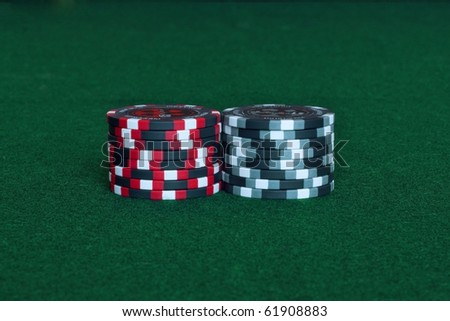 Casino chips on a green cloth