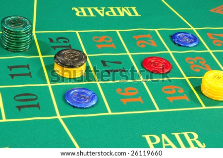 Casino chips on green felt