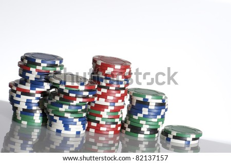 casino chips  stacked on a white table - stock photo