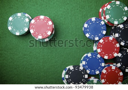 casino chips stacking on a green felt