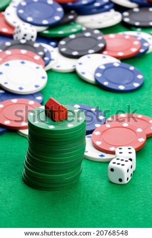 Casino chips with toy house - housing market gamble concept