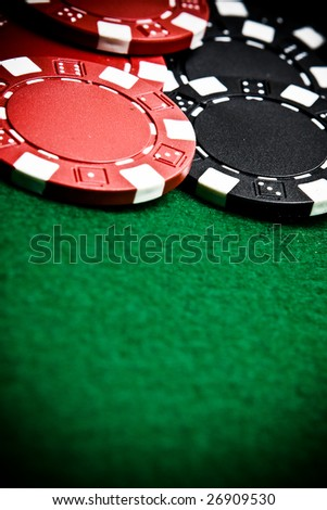 Casino gambling chips with copy space - vignette - stock photo
