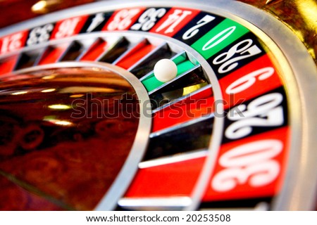 casino roulette close up with the ball on number zero