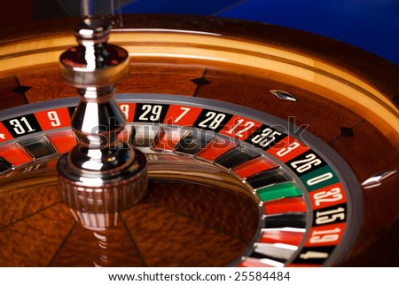 Casino roulette on blue background - stock photo