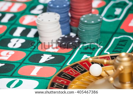 casino roulette wheel with the ball on number 7 - stock photo