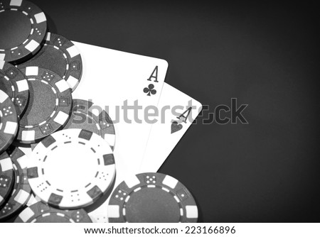 Casino table with a pair of aces and chips - stock photo
