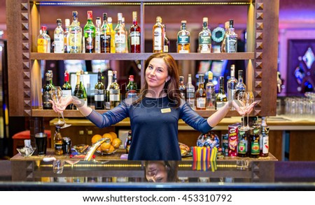 CASINO TORNADO BAR, LITHUANIA - 09 FEBRUARY 2016: Barmen with wineglasses at the bar. Klaipeda, Lithuania.