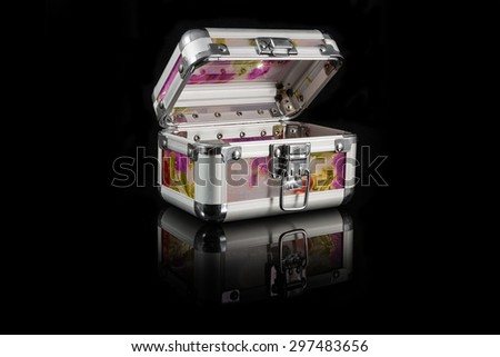 Casket with a cover on a black background