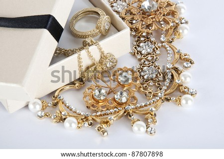 Casket with Jewelry on a white background - stock photo