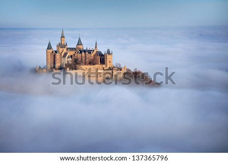 Caslte Hohenzollern over the clouds - stock photo
