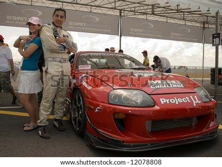 Casper Canul posing with spectator in the paddock at the inaugural Formula Drift Singapore, an event held on 27 Apr 2008. - stock photo