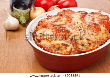 casserole dish with classic greek moussaka with eggplant - stock photo