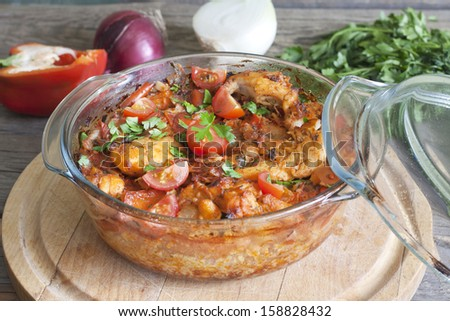 Casserole of chicken in an ovenproof dish with vegetables - stock photo
