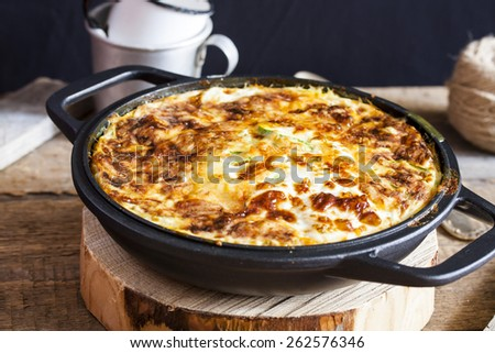 casserole of rice, vegetables, cheese and zucchini - stock photo