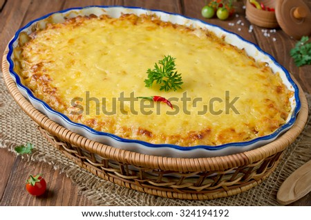 Casserole with cabbage and meat under a cheese crust - stock photo