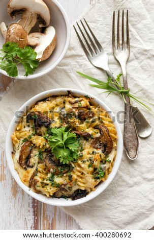 Casserole with fusilli pasta, mushrooms, cheese and herbs