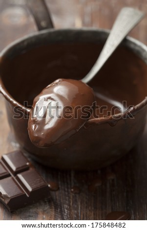 casserole with melted chocolate - stock photo