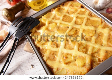 Casserole with potatoes, cheese and meat - stock photo