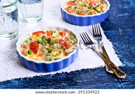 Casserole with rye pasta and vegetables in a portion of the ceramic forms