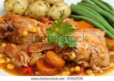 Casseroled chicken with new potatoes and green beans - stock photo