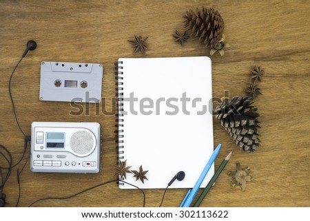 cassette tape audio player and blank paper vintage still life  - stock photo