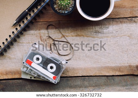Cassette tapes on wooden table.vintage effect.