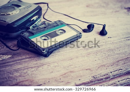 Cassette tapes over wooden table. - stock photo
