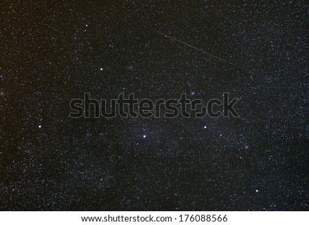 Cassiopeia constellation with shooting star. - stock photo
