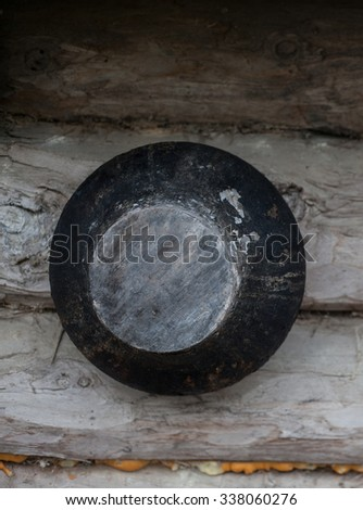 Cast iron a large pot, the pot from the iron round to extinguish the fire and boiling in the Russian oven. - stock photo