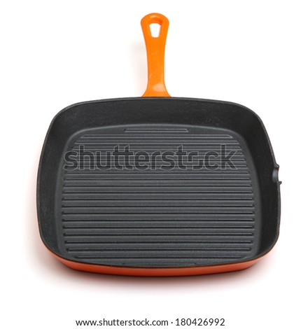 Cast iron griddle or skillet pan isolated on white - stock photo