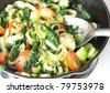 Cast Iron Skillet with Lots of Different Vegetables Sauteed in Olive Oil - stock photo