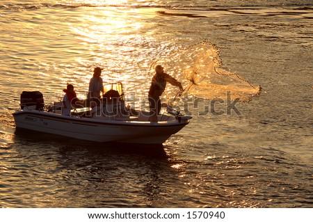Cast net fisherman silhouette - stock photo