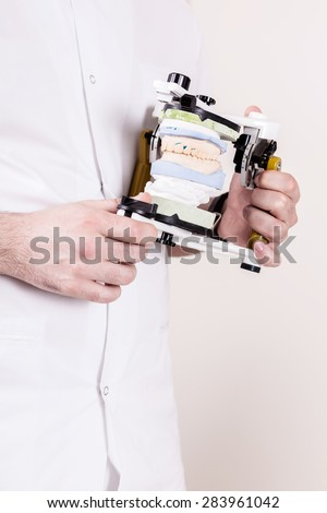 cast tooth - stock photo