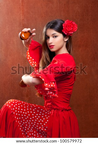 Castanets gypsy flamenco dancer Spain girl with red rose - stock photo
