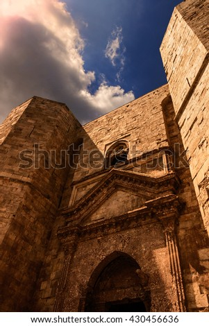 Castel del Monte: the main facade: portal.-ITALY(Apulia)-Unesco world heritage site.Castle entrance built into the octagonal towers. - stock photo