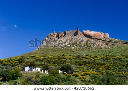 Castel Rosso also known as Red Castle near Karystos, Evia, greece against a blue sky and moon - stock photo
