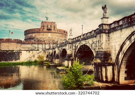 Castel Sant'Angelo, Rome, Italy. View from the other side of the Tiber river and Ponte Sant'Angelo bridge. Vintage - stock photo