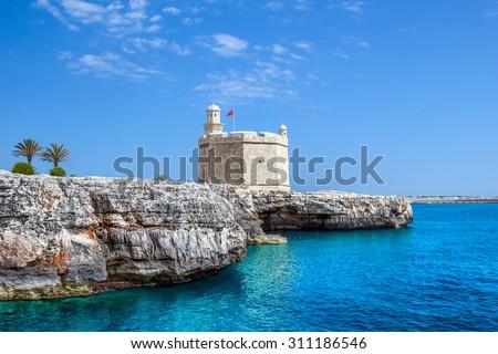Castell de Sant Nicolau at the port mouth of Ciutadella de Menorca, Spain. - stock photo
