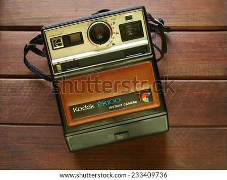 Castellon,Spain.November 26,2014.Old instant camera on a wooden table      - stock photo