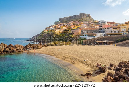 CASTELSARDO,ITALY - SEPTEMBER 21,2014 - Beach in Sardinian Castelsardo.The coastline of Castelsardo is characterised by the trachytic rock typical of the zone . - stock photo