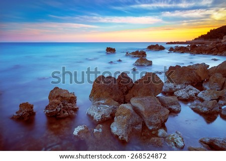 Castiglioncello travel destination rock and sea on sunset. Tuscany, Italy, Europe. Long Exposure